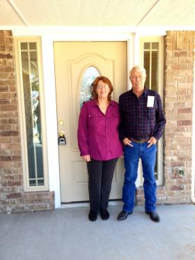 Bettie and Joel Spears in front of their new home.