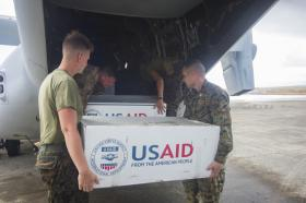 Marines and U.S. Army Soldiers load supplies onto an MV-22 Osprey assigned to assist the Philippine government in response to the aftermath of Super Typhoon Haiyan - November 14, 2013.