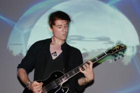 Guitarist, drummer, songwriter, and Oklahoma native Benjamin Curtis playing with School of Seven Bells at the Bowery Ballroom in New York City - June 12, 2009.