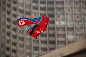 North Korea flag with building in background