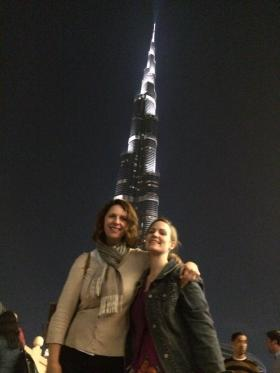 Suzette Grillot and Rebecca Cruise stand in front of Burj Khalifa in Dubai, the world's tallest building.