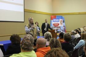 Oklahoma Insurance Commissioner John Doak speaks at a tax forum for tornado survivors.