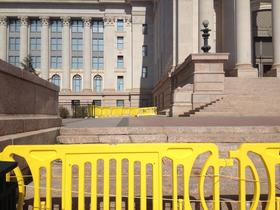 Barricades surround the Oklahoma State Capitol to protect bystanders from potential falling debris.