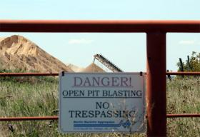 A gate into a silica sand mining operation near Mill Creek in south-central Oklahoma.