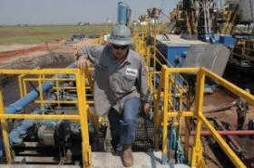 Toolpusher and rig manager Darrin Silcot walks the perimeter of a Triad Energy horizontal drilling operation near Alva, Okla. The company's CEO, Mike McDonald, says the tax incentive for horizontal drilling has led to more drilling at his company and othe