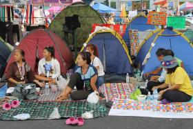 Protesters watch speeches in a tent city in Thailand's capital Bangkok - February 18, 2014.