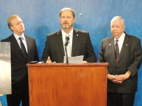 State Sen. Randy Bass (D-Lawton) pushing to get bill heard allowing voters to block horse slaughter plants, flanked by Canadian County Undersheriff Chris West and Oklahoma County Commissioner Brian Maughan.