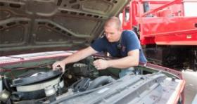 T.J. Coley, with the Choctaw Fire Department, checks the engine on a firetruck. The truck was a surplus from the Oklahoma Department of Agriculture, Food and Forestry.