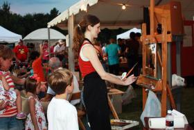 Regional artist Kelli Folsom presents a live painting demonstration at Norman's Midsummer Nights Art Festival in 2012.