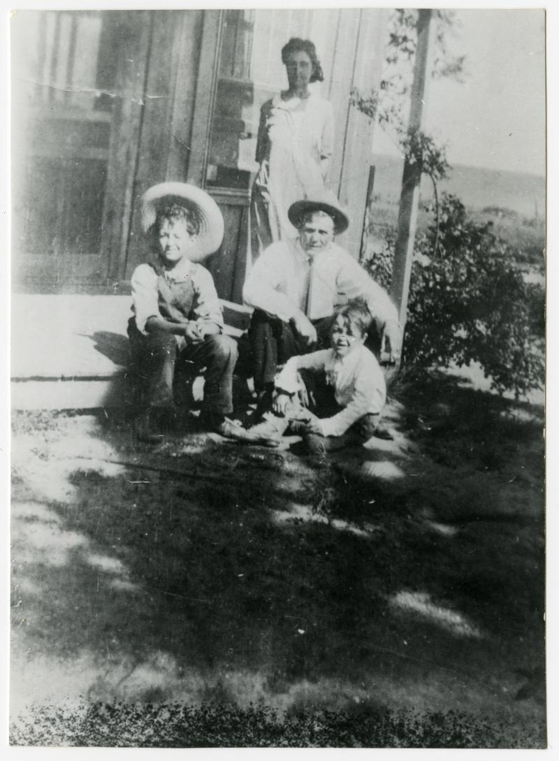 Woody with his parents Nora Belle and Charley, and brother George, at their home in Okemah, Oklahoma, 1926.