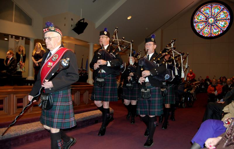 The Oklahoma Scottish Pipes and Drums process at the start of the 18th anniversary remembrance ceremony Friday.