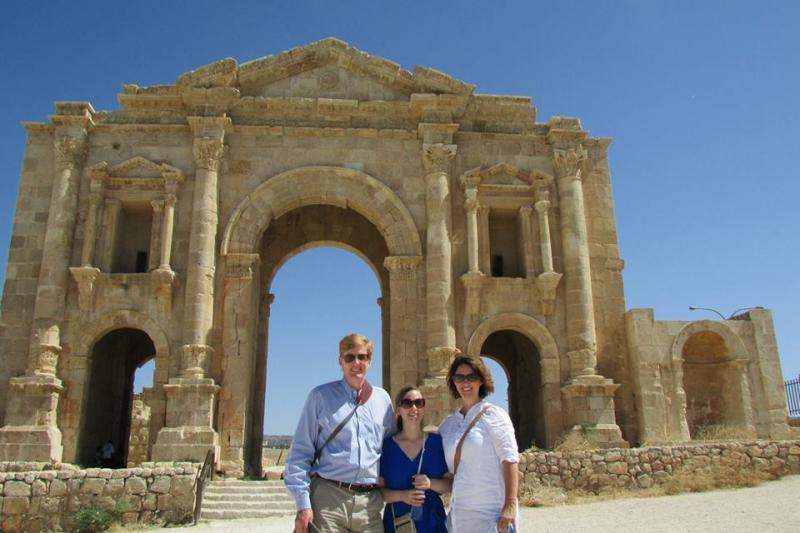 Joshua Landis, Rebecca Cruise, and Suzette Grillot in front of the Arch of Hadrian at the Greco-Roman ruins in Jerash, Jordan
