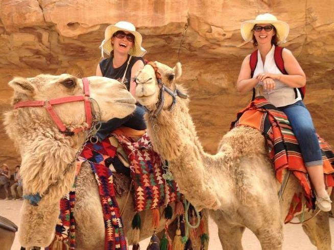 Rebecca Cruise and Suzette Grillot arrive via camel to the Treasury.
