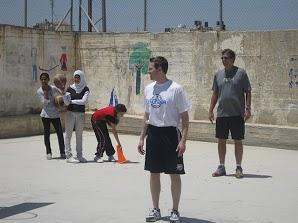 Oklahoma City Thunder General Manager Sam Presti works with PeacePlayers International campers in Tel Aviv, Israel