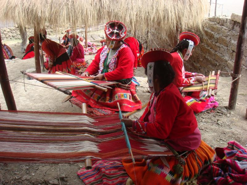 Women supporting themselves in a textile factory in Peru.