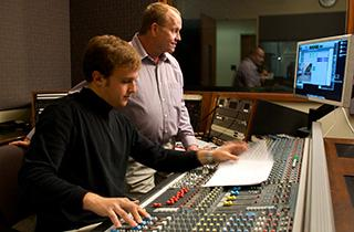 Jeremy Gossett with Kini Kay at mixing board, overseeing recording session