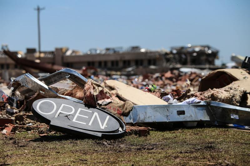 Debris filled the streets in Moore, Okla. on May 20, 2013.