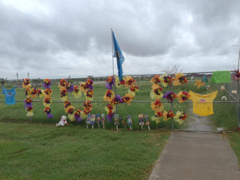 "fence in Moore, Oklahoma with ""Hope"" written in flowers"