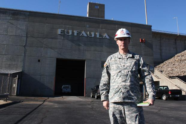 Retired Col. Michael Teague, Secretary of Energy and Environment, stands in front of a dam at Lake Eufaula.