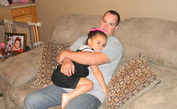Dusten Brown with his daughter, Veronica, before her return to her adoptive parents in South Carolina.