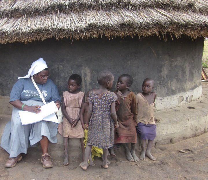 Sister Rosemary Nyirumbe with children in Uganda.