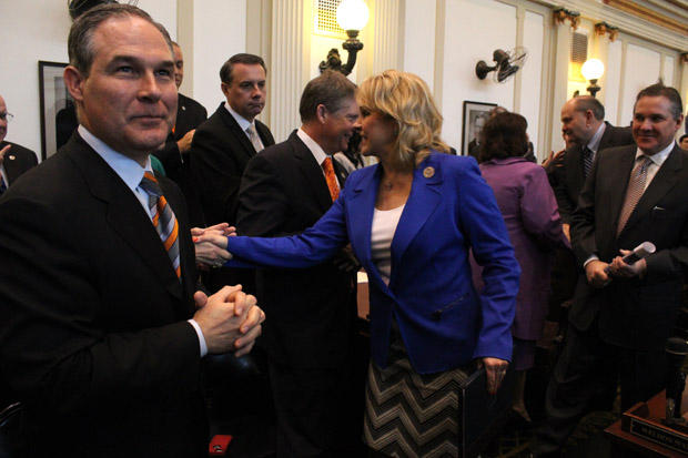 Oklahoma Attorney General Scott Pruitt prepares to greet Gov. Mary Fallin at the 2013 State of the State address at the state capitol.