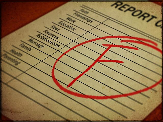a report card with a large, red letter F circled