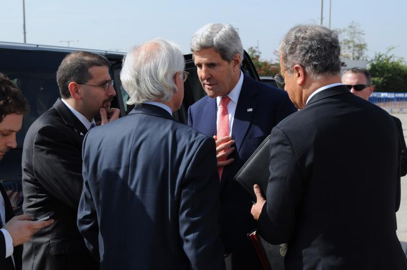 U.S. Secretary of State John Kerry speaks with U.S. Ambassador to Israel Daniel Shapiro, U.S. Special Envoy for Israeli-Palestinian Negotiations Martin Indyk, and Deputy Special Envoy Frank Lowenstein about Middle East peace negotiations before departing