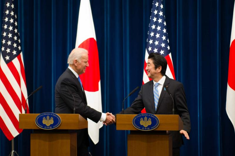 Vice President Joseph Biden shakes hands with Japanese Prime Minister Shinzo Abe after their meeting in Tokyo, Japan, on Tuesday.