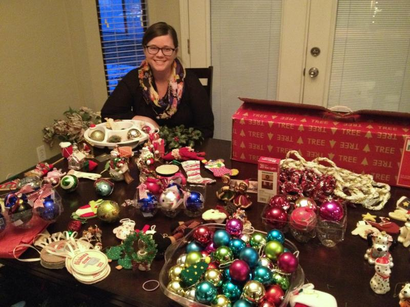 Kim Rollins sits with some of the donated ornaments she has acquired over the past few weeks.