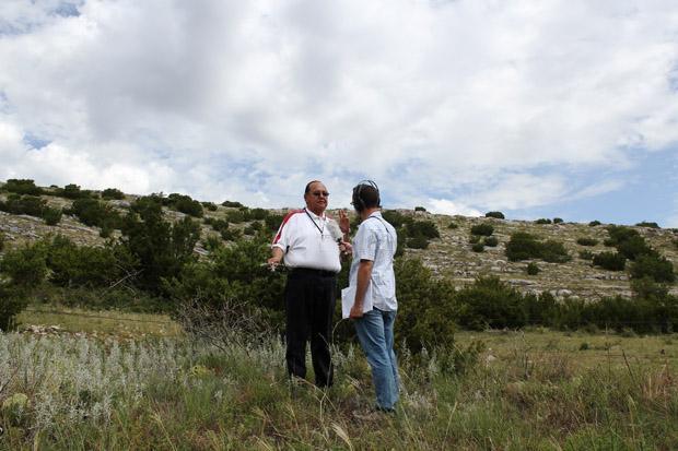 Logan Layden talks with Kiowa historian 'Joe Fish' DuPoint about the potential impact of limestone mining on Longhorn Mountain in August 2013.