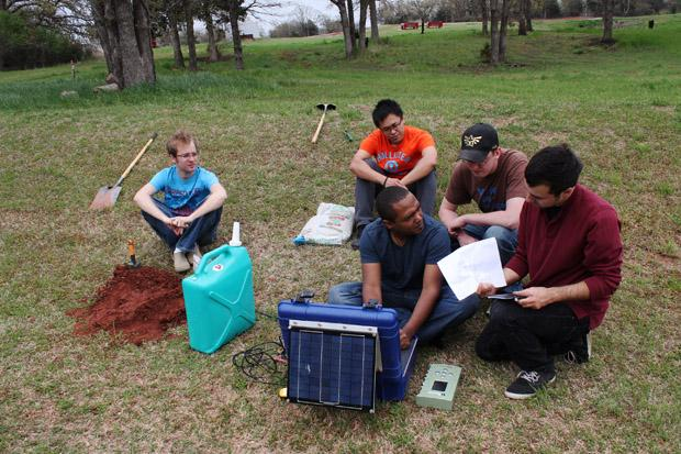 University of Oklahoma graduate students near Wellston, Okla., installing a seismometer to study central-Oklahoma's earthquake swarm