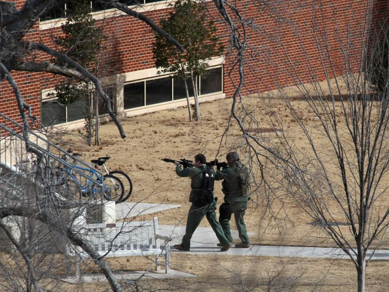 Tactical units respond to a report of a shooting on the University of Oklahoma campus.
