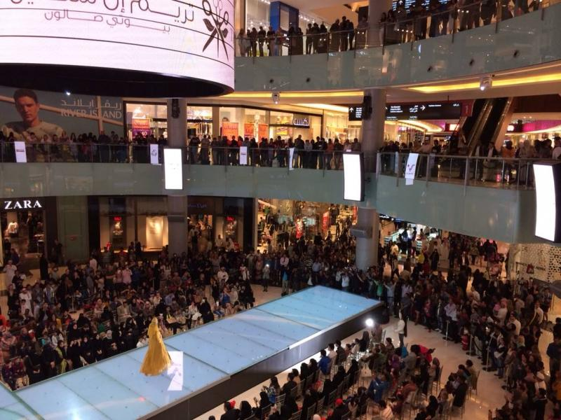 Crowds gather to watch a fashion show inside the Dubai Mall, the world's largest shopping mall.