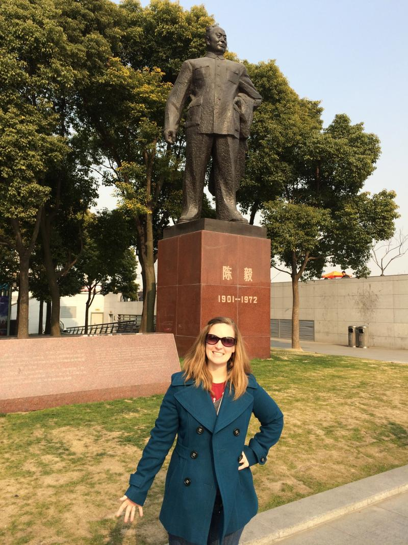 Rebecca Cruise in front of a statue of Chen Yi, a former foreign minister and the first mayor of Shanghai.