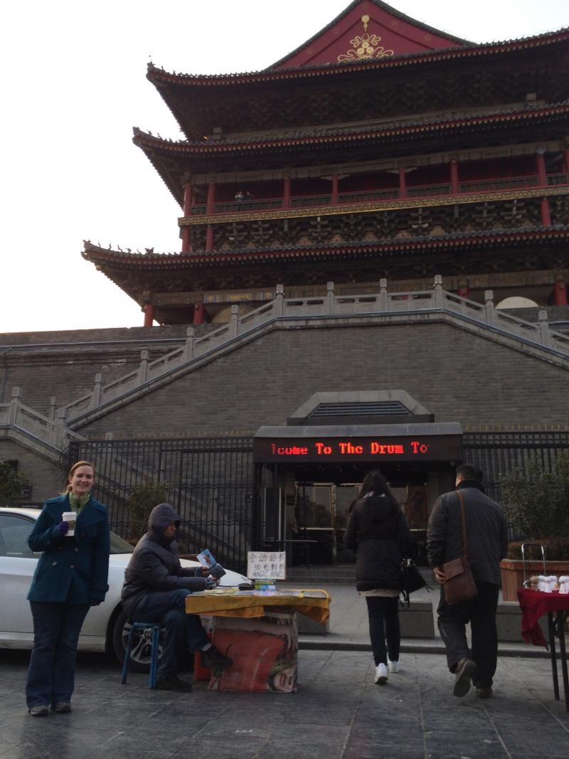 Rebecca Cruise standing in front of the Drum Tower of Xi'an