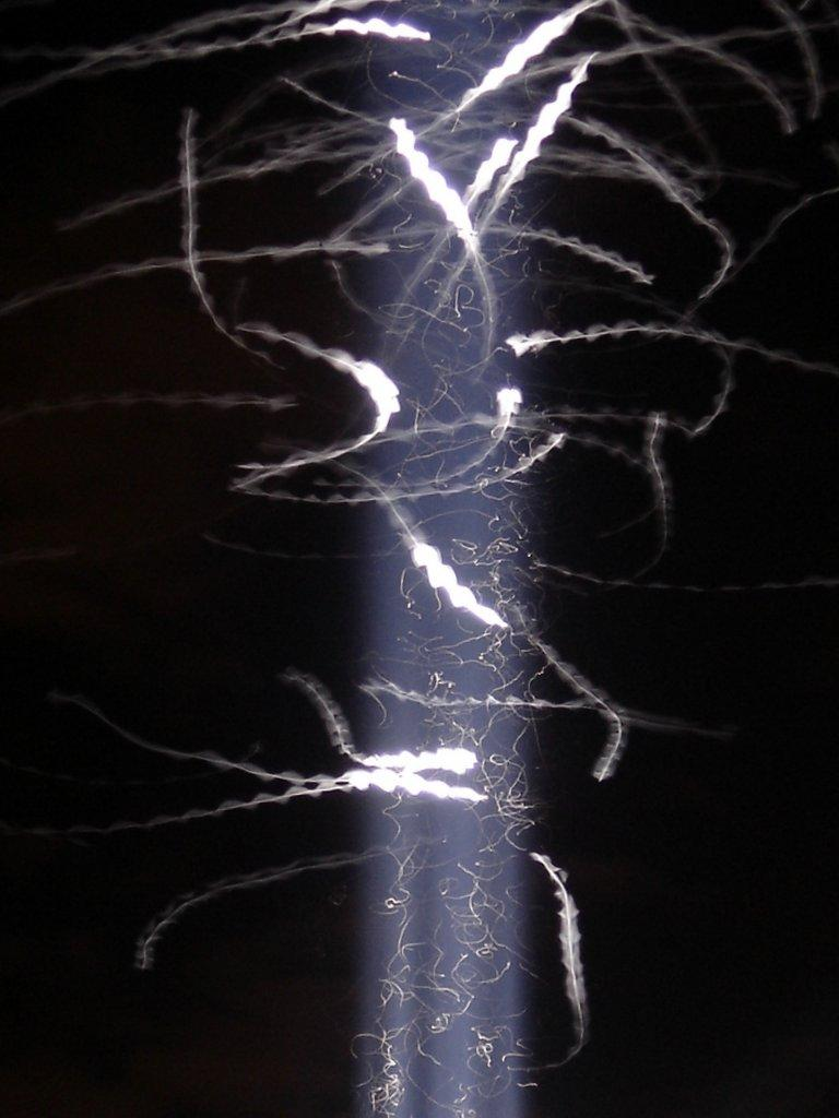 A long exposure close-up shot of the light above the Luxor Las Vegas. A 2013 article by the Las Vegas Review-Journal estimates an entire ecosystem of birds, bugs, bats, and owls has developed around the light.