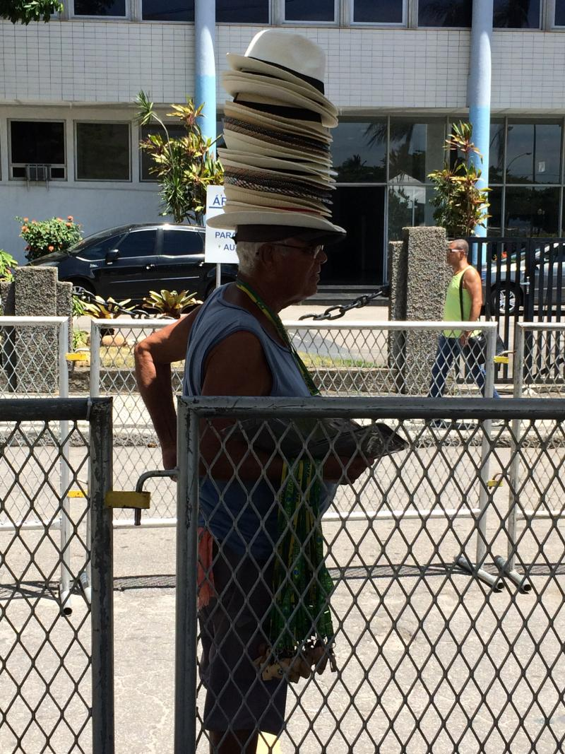 A street vendor sells hats on the streets of Rio.