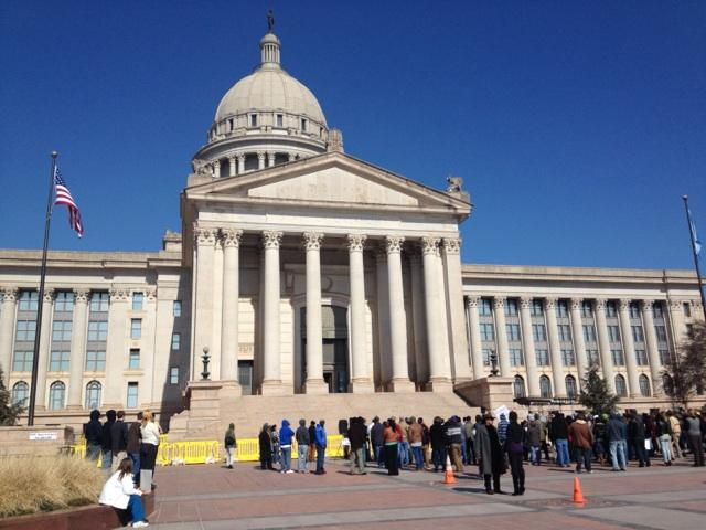 Dozens of supporters rally on the south steps of the state Capitol in support of legislation to legalize marijuana in Oklahoma.