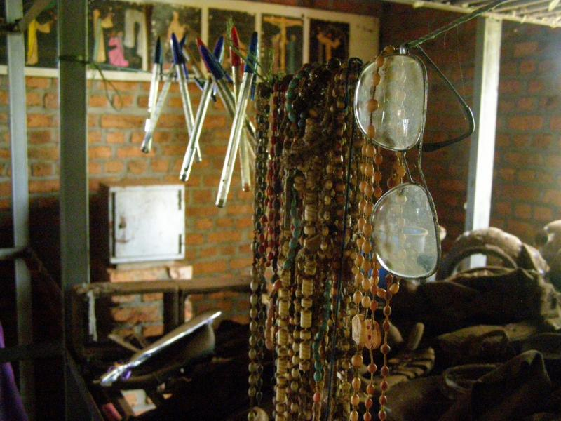 In 1994, 800,000 people were killed in 100 days of systematic slaughter. Many sites around Rwanda now stand as memorials to the genocide. Here, people's personal items are collected. Glasses, pens, rosaries, collected from those who were killed.