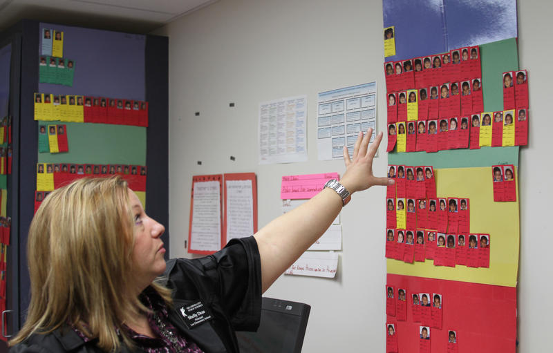Shelly Deas, principal of Lee Elementary School in Oklahoma City, shows the school's system for tracking achievement and improvement levels of each student. Students in blue are at the highest performing level; students in red are at the lowest.