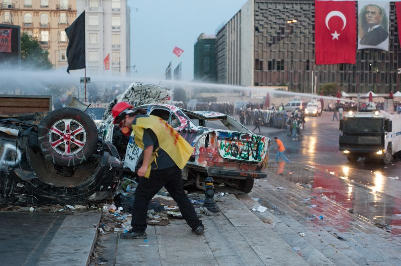 Riot police cleaning Taksim Square after protests - June 16, 2013