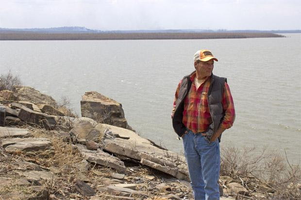 Rick Geisler, manager of Wah-Sha-She Park in Osage County, stands on the shore of Hula Lake.