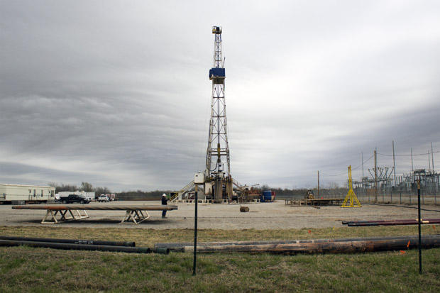 Rig crews in Oklahoma City fracking a well.