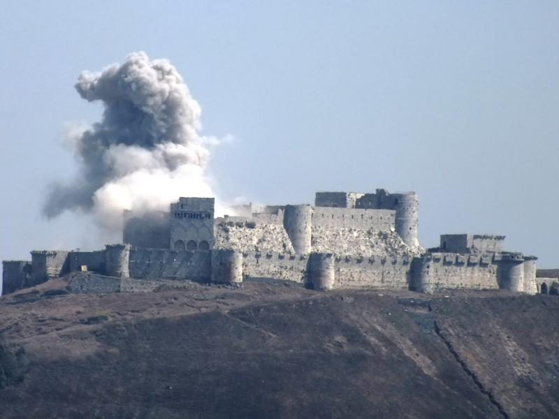 Smoke emerges from the castle at Krak des Chavaliers in Syria - August 18, 2013.
