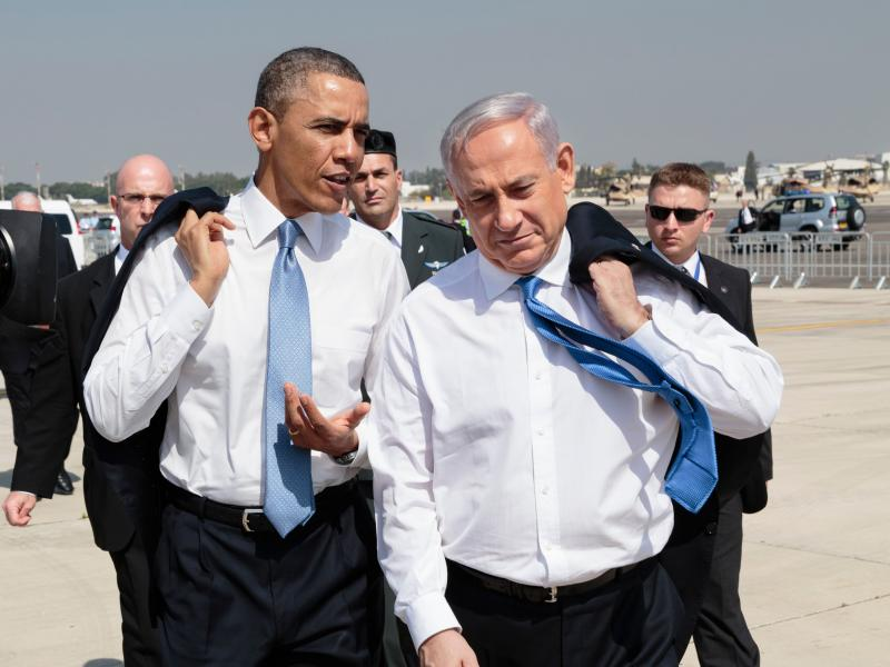 President Barack Obama walks across the tarmac with Israeli Prime Minister Benjamin Netanyahu at Ben Gurion International Airport in Tel Aviv, Israel, March 20, 2013.
