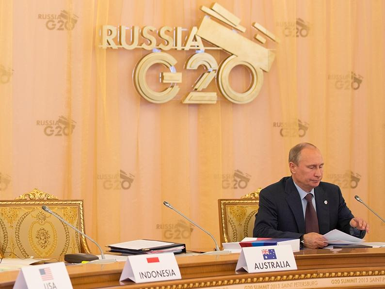 President Vladimir Putin opens an afternoon plenary session at Konstantinovsky Palace during the G20 Summit in Saint Petersburg, Russia, Sept. 6, 2013.