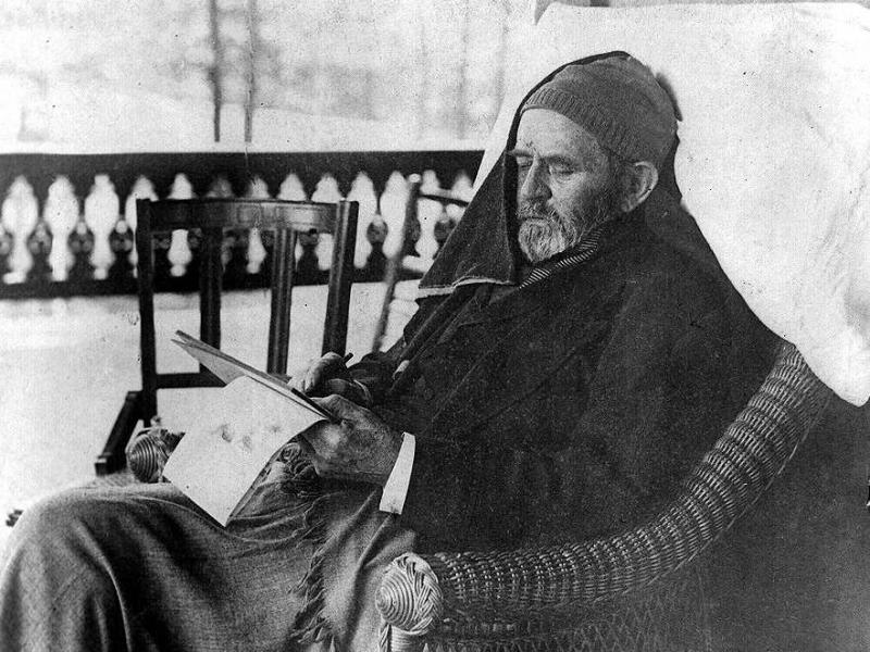 Ulysses S. Grant, seated in arattan chair, writing his memoirs, at Mount McGregor near Saratoga Springs, N.Y. in the months before his death in 1885.