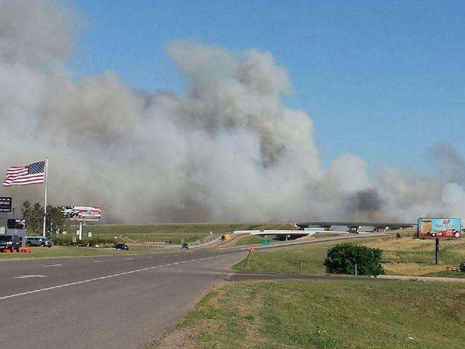 Smoke billowing from the wildfire that started in Logan County near Guthrie Sunday afternoon.