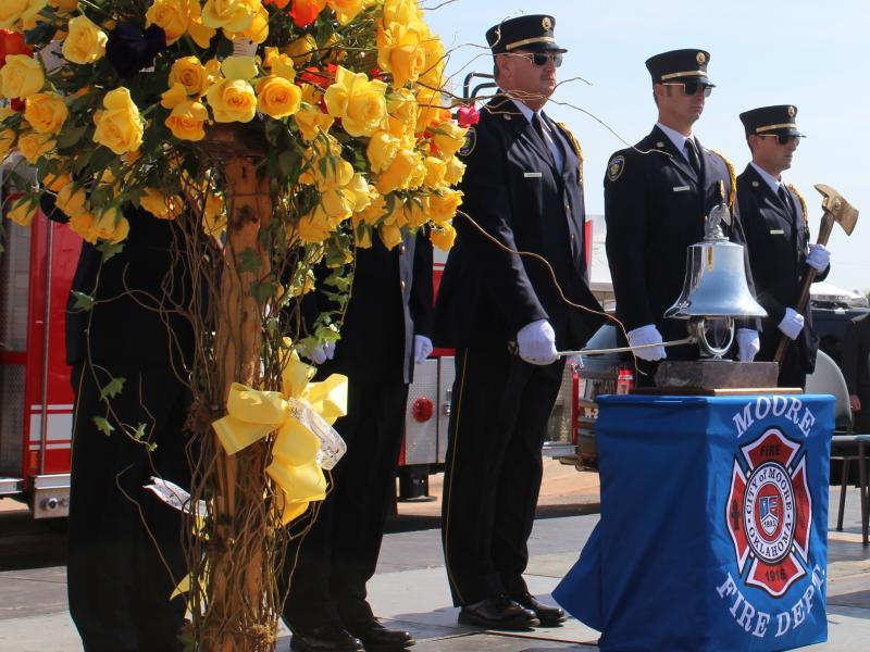 The Moore Fire Department Honor Guard rings a bell to honor each of the 25 victims of the May 20, 2013 tornado.